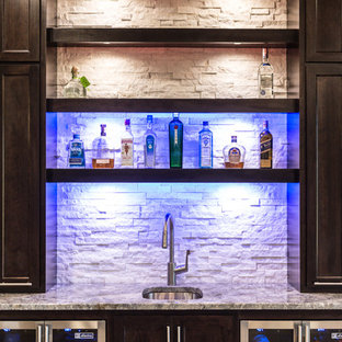 Inspiration for a huge contemporary single-wall light wood floor wet bar remodel in Chicago with an undermount sink, shaker cabinets, dark wood cabinets, granite countertops, white backsplash and stone tile backsplash