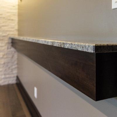 Huge trendy single-wall light wood floor wet bar photo in Chicago with an undermount sink, shaker cabinets, dark wood cabinets, granite countertops, white backsplash and stone tile backsplash