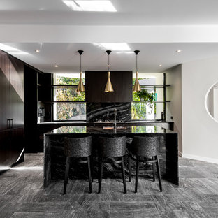 Contemporary bold kitchen with feature granite and brass pendant lighting