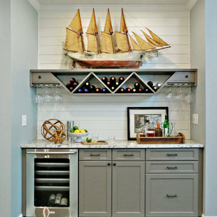 Inspiration for a large classic single-wall home bar in Atlanta with shaker cabinets, grey cabinets, marble worktops, grey splashback, medium hardwood flooring, brown floors and grey worktops.