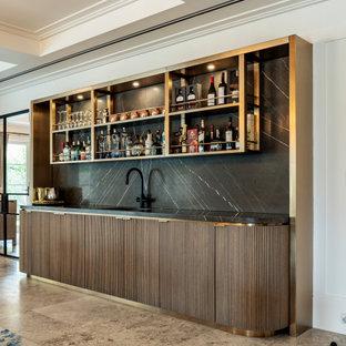 Contemporary single-wall wet bar in Sydney with an undermount sink, flat-panel cabinets, dark wood cabinets, black splashback, stone slab splashback, brown floor and black benchtop.