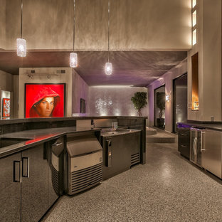 Wet bar - mid-sized contemporary u-shaped wet bar idea in Omaha with an undermount sink and flat-panel cabinets