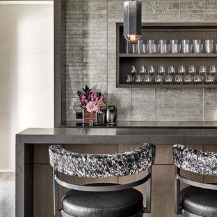 Home bar - contemporary home bar idea in Chicago with gray countertops