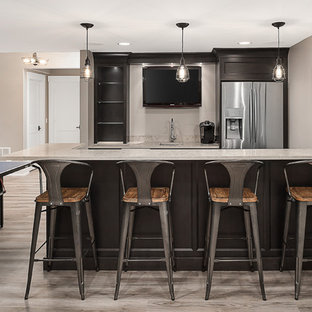 Large transitional l-shaped vinyl floor and brown floor wet bar photo in Chicago with an undermount sink, shaker cabinets, black cabinets, quartz countertops and beige countertops