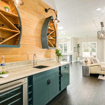 Example of a beach style single-wall dark wood floor and brown floor wet bar design in Los Angeles with an undermount sink, flat-panel cabinets, blue cabinets and brown backsplash