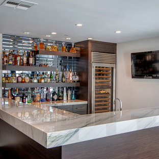 Photo of a large contemporary l-shaped wet bar in Orange County with a built-in sink, flat-panel cabinets, brown cabinets, marble worktops, blue splashback, mirror splashback, porcelain flooring, brown floors and grey worktops.