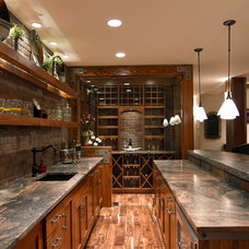 Traditional Home Bar by Eden Design