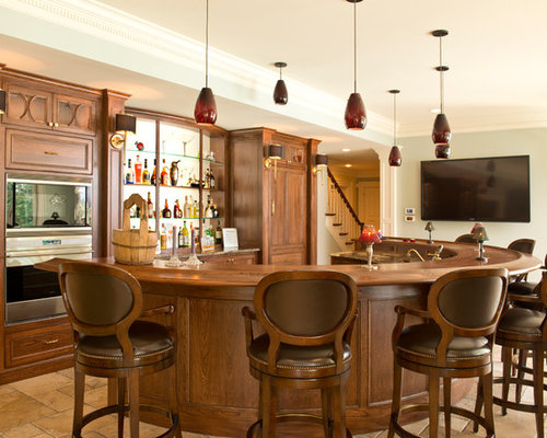 Traditional Limestone Floor Seated Home Bar Idea In Columbus With Recessed Panel Cabinets Dark