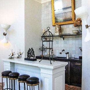 Medium sized traditional galley breakfast bar in New York with a submerged sink, flat-panel cabinets, black cabinets, marble worktops, blue splashback, porcelain splashback, brick flooring and brown floors.