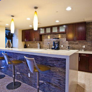 Photo of an expansive contemporary single-wall wet bar in Las Vegas with flat-panel cabinets, dark wood cabinets, multi-coloured splashback, matchstick tiled splashback, porcelain flooring, beige floors, beige worktops, a built-in sink and composite countertops.