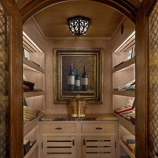 デトロイトの中くらいのトラディショナルスタイルのおしゃれなホームバー (ll型、シンクなし、淡色木目調キャビネット、大理石カウンター、レンガの床、ベージュの床、オープンシェルフ) の写真