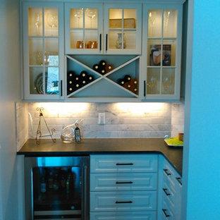 Inspiration for a classic home bar in Detroit with white cabinets, granite worktops, white splashback, marble splashback and medium hardwood flooring.