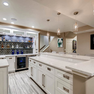 Photo of a small contemporary u-shaped wet bar in Denver with a submerged sink, shaker cabinets, white cabinets, engineered stone countertops, brown splashback, wood splashback, ceramic flooring, grey floors and white worktops.