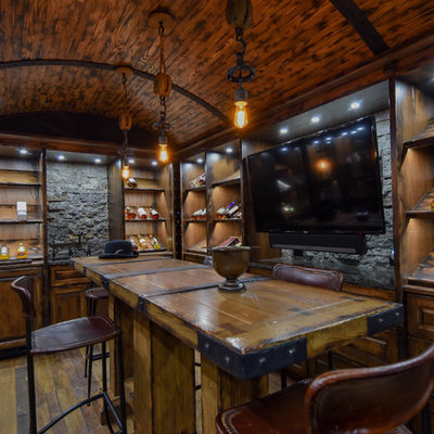 Example of a large mountain style u-shaped medium tone wood floor and brown floor seated home bar design in Edmonton with raised-panel cabinets, dark wood cabinets, wood countertops, brown backsplash, wood backsplash and brown countertops