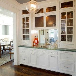 Design ideas for a medium sized nautical single-wall wet bar in New York with a built-in sink, recessed-panel cabinets, white cabinets, mirror splashback, dark hardwood flooring, brown floors and green worktops.