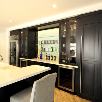 Dark Stained Maple Cabinets in Basement Bar with Full Sized 36 SubZero Pro Refri