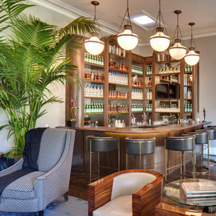 Large l-shaped dark wood floor seated home bar photo in Los Angeles with open cabinets, medium tone wood cabinets, wood countertops and mirror backsplash