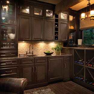 Mid-sized elegant l-shaped wet bar photo in Denver with an undermount sink, dark wood cabinets, gray backsplash, flat-panel cabinets, granite countertops and stone tile backsplash