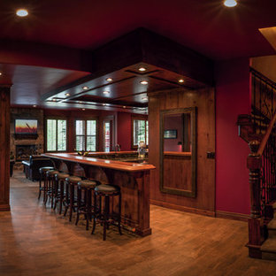 Seated home bar - large southwestern l-shaped dark wood floor seated home bar idea in Salt Lake City with beaded inset cabinets, dark wood cabinets, wood countertops, an undermount sink, multicolored backsplash and brown countertops
