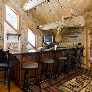 Inspiration for a mid-sized rustic l-shaped medium tone wood floor seated home bar remodel in Denver with dark wood cabinets and granite countertops