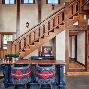 Mountain style home bar photo in Denver
