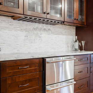 Inspiration for a medium sized traditional single-wall wet bar in Richmond with no sink, shaker cabinets, dark wood cabinets, marble worktops, white splashback, matchstick tiled splashback, light hardwood flooring and brown floors.
