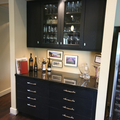 Mid-sized trendy galley dark wood floor and brown floor wet bar photo in Houston with flat-panel cabinets, granite countertops, no sink and black cabinets