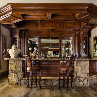 Large elegant u-shaped porcelain floor and brown floor seated home bar photo in Atlanta with an undermount sink, recessed-panel cabinets, dark wood cabinets, granite countertops and brown backsplash