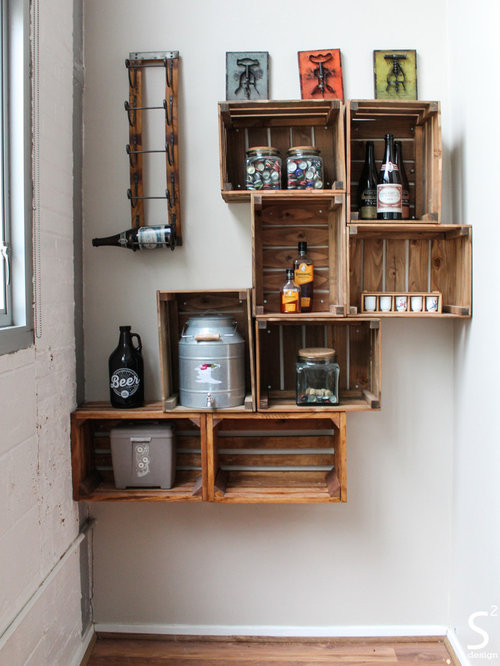 Inspiration For A Small Industrial Home Bar Remodel In Houston