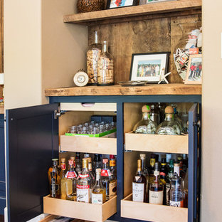 Mid-sized elegant single-wall dark wood floor home bar photo in Orange County with beaded inset cabinets, blue cabinets, wood countertops and wood backsplash