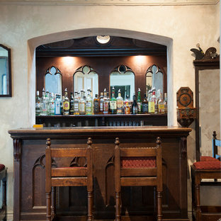 Inspiration for a small victorian single-wall home bar in Other with open cabinets, granite worktops, mirror splashback, carpet, red floors and brown worktops.