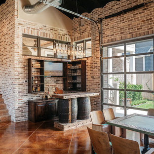 Inspiration for an industrial concrete floor and brown floor home bar remodel in Houston with open cabinets, dark wood cabinets and brick backsplash