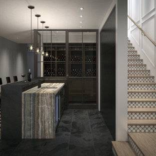 Example of a mid-sized trendy l-shaped slate floor and black floor wet bar design in Calgary with an undermount sink, recessed-panel cabinets, dark wood cabinets and marble countertops