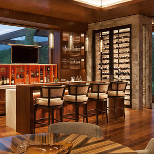 Example of a huge mountain style dark wood floor and brown floor seated home bar design in Denver with dark wood cabinets and recessed-panel cabinets