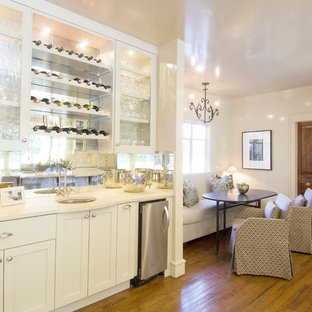 Design ideas for a medium sized classic single-wall wet bar in Austin with a submerged sink, shaker cabinets, white cabinets, mirror splashback and medium hardwood flooring.