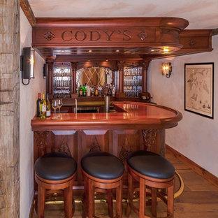 Example of a classic home bar design in Burlington
