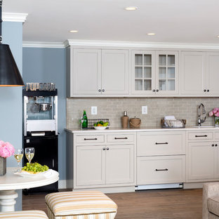 Photo of a traditional single-wall wet bar in DC Metro with beige cabinets, marble worktops, beige splashback, shaker cabinets and metro tiled splashback.