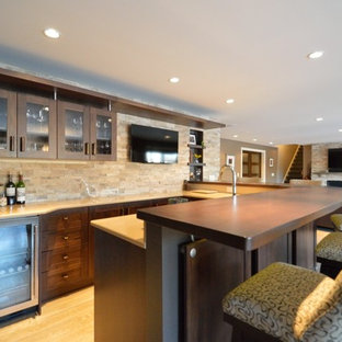 Trendy l-shaped linoleum floor seated home bar photo in New York with an undermount sink, glass-front cabinets, dark wood cabinets, wood countertops, multicolored backsplash and stone tile backsplash