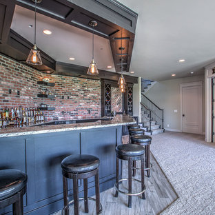 Example of a mid-sized classic l-shaped ceramic floor wet bar design in Omaha with an undermount sink, shaker cabinets, black cabinets, granite countertops and red backsplash