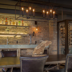 Exposed Brick Wall Bar Poured Concrete Counter Glassed In Wine Room