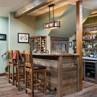 Seated home bar - rustic galley dark wood floor and brown floor seated home bar idea in Denver with wood countertops and brown countertops
