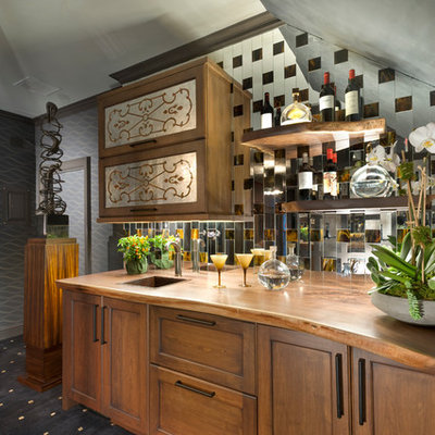 Wet bar - transitional single-wall wet bar idea in New York with a drop-in sink, shaker cabinets, medium tone wood cabinets and mirror backsplash