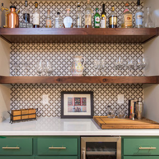 Home bar - transitional l-shaped brown floor home bar idea in Los Angeles with shaker cabinets, green cabinets, quartz countertops, multicolored backsplash, porcelain backsplash and white countertops