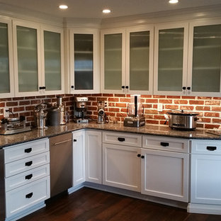Mid-sized cottage l-shaped dark wood floor home bar photo in New York with recessed-panel cabinets, white cabinets, granite countertops, red backsplash and stone tile backsplash