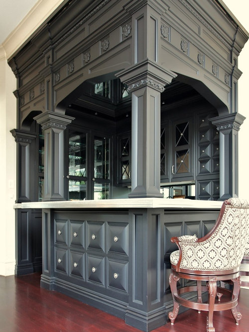 small elegant u shaped dark wood floor seated home bar photo in st louis with - Beaded Inset House 2016