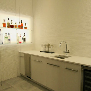 Photo of a medium sized modern single-wall wet bar in Denver with a submerged sink, flat-panel cabinets, white cabinets, engineered stone countertops, white splashback, porcelain splashback, porcelain flooring and grey floors.