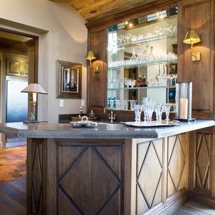 Large elegant l-shaped wet bar photo in Orange County with raised-panel cabinets, medium tone wood cabinets, quartzite countertops and gray countertops