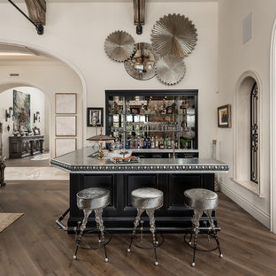 Inspiration for a huge shabby-chic style l-shaped medium tone wood floor and brown floor seated home bar remodel in Phoenix with a drop-in sink, open cabinets, black cabinets, zinc countertops, multicolored backsplash, mirror backsplash and gray countertops
