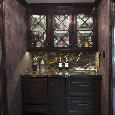 Example of a small trendy single-wall porcelain tile and gray floor wet bar design in St Louis with no sink, raised-panel cabinets, dark wood cabinets, granite countertops, brown backsplash and stone slab backsplash