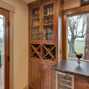 This is an example of a small rustic single-wall home bar in Portland with shaker cabinets, medium wood cabinets, marble worktops and light hardwood flooring.